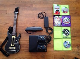 Black xbox 360 console with controller and game cases, Kinect .
