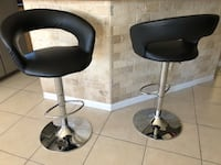Two contemporary adjustable high stools  1143 mi