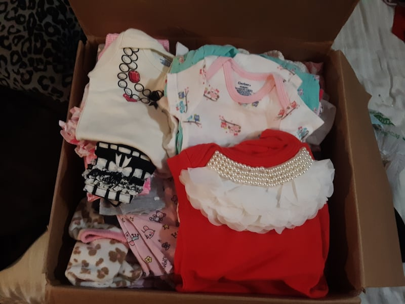 Box of baby clothes 6ae3abb5-868e-4ce7-b255-d3cc0ec688f7