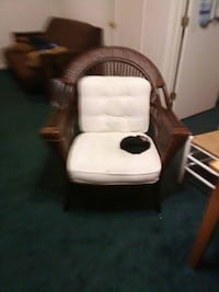 white and black leather rolling armchair