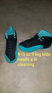 pair of black-and-teal Nike basketball shoes Oklahoma City