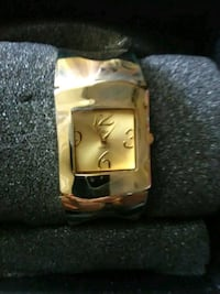 square gold analog watch with gold link bracelet Leesburg, 34748