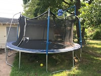 black and blue trampoline with enclosure Garland, 75041
