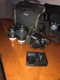 black Canon DSLR camera with lens and bag Pembroke Pines