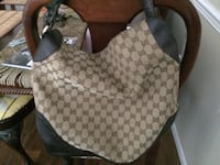 Gray and white monogrammed gucci backpack 1074 mi