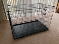 "Black metal folding dog crate.  Height 32"". Width 29 1/2"".  Length 48"" Vienna, 22180"