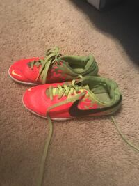 Pink-and-green Nike soccer shoes cleats  Spring, 77379