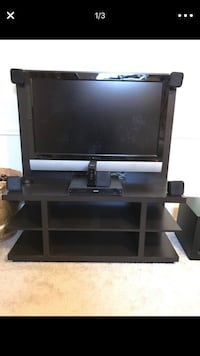 Espresso Entertainment Stand (TV sold separately) good condition. Entertainment center in a dark brown almost black. Espresso color. You can mount a TV directly to it or just leave it on its stand. Lewisville, 75077