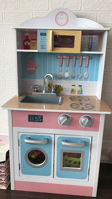 white, pink and cyan wooden kitchen toy set