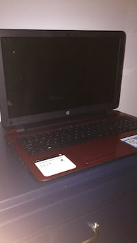 Black and red hp laptop