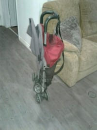 baby's red and black umbrella stroller Gatineau, J8P 2R2