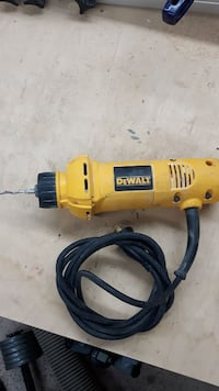 yellow and black DEWALt corded power drill Montreal, H1C 0B2