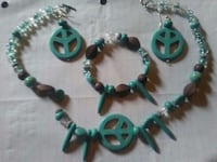 green and brown beaded necklace,pair of earrings,and bracelet Farmville, 23901