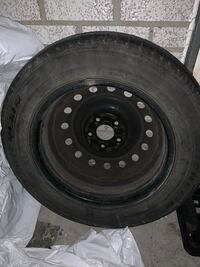 Black bullet hole car wheel with tire Toronto, M1L 1W6