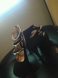 pair of black leather open-toe heeled sandals Five Points, 93624