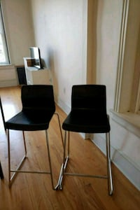 two black-and-gray bar stools 25 mi