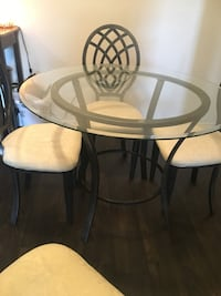round glass top table with four chairs Las Vegas, 89147