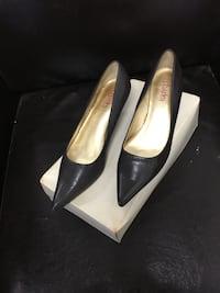 Pair of black charles pointed toe leather pumps