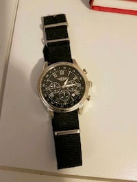 round silver chronograph watch with black leather  Surrey, V4N 5M2