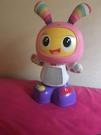 pink and yellow Fisher-Price musical animal toy