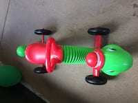 green and red worm ride on toy