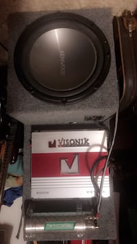 Gray and black kenwood vehicle subwoofer speaker and amplifier