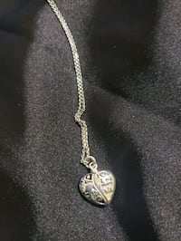 Silver opening heart necklace