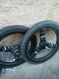 two black 3-spoke motorcycle-wheels with tire set