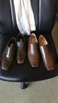 two pairs of brown leather loafers