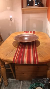 round brown wooden table with four chairs dining set Pawtucket, 02860
