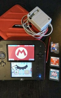 Nintendo 2DS w/ 2 games, charger, stylus, case + brand new Mario toy