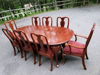 round brown wooden table with four chairs dining s Middletown, 06481