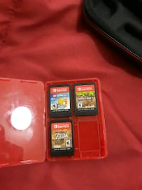 Netendo switch games with small red game case Des Moines, 50315