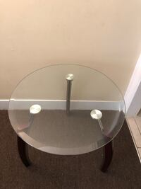 Round glass top table with gray metal base Darby township, 19079