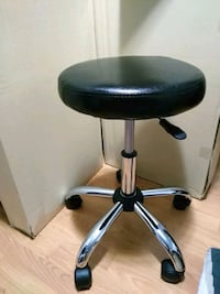 Black adjustable rotating stool Vancouver, V6P 4A7