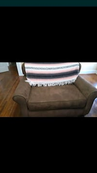 Brown microfiber loveseat with bed Cookeville