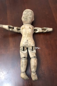 Vintage wooden doll from the late 1911