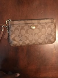 brown monogrammed Coach leather wristlet New York, 11238