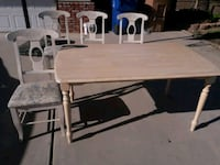 rectangular brown wooden table with chairs Bakersfield, 93309