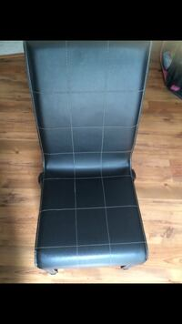 Black leather padded chairs 4 in total