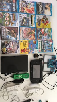 black Nintendo Wii console with game cases Edmonton, T6A 3J1