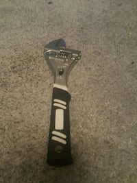 silver and black adjustable wrench
