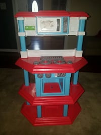 red, blue, and white kitchen playset 38 km