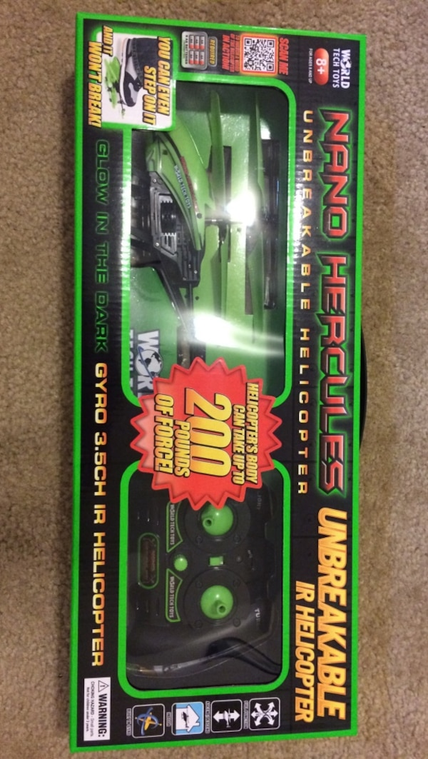 Used Green and black nano hercules r/c helicopter set for
