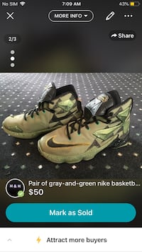 pair of white-and-green Nike basketball shoes Toronto, M4J 3C9