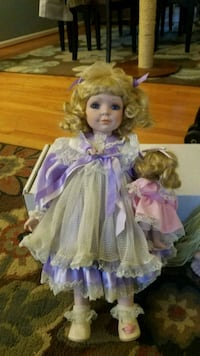 girl doll wearing purple dress 41 km