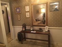 brown wooden framed wall mirror Houston, 77063