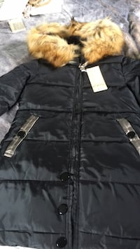 Down puffy jacket 3/4 length with champagne accents. Very cute!!