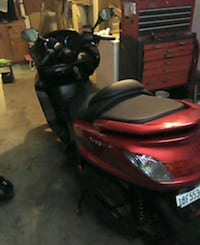 red and black motor scooter 2202 mi