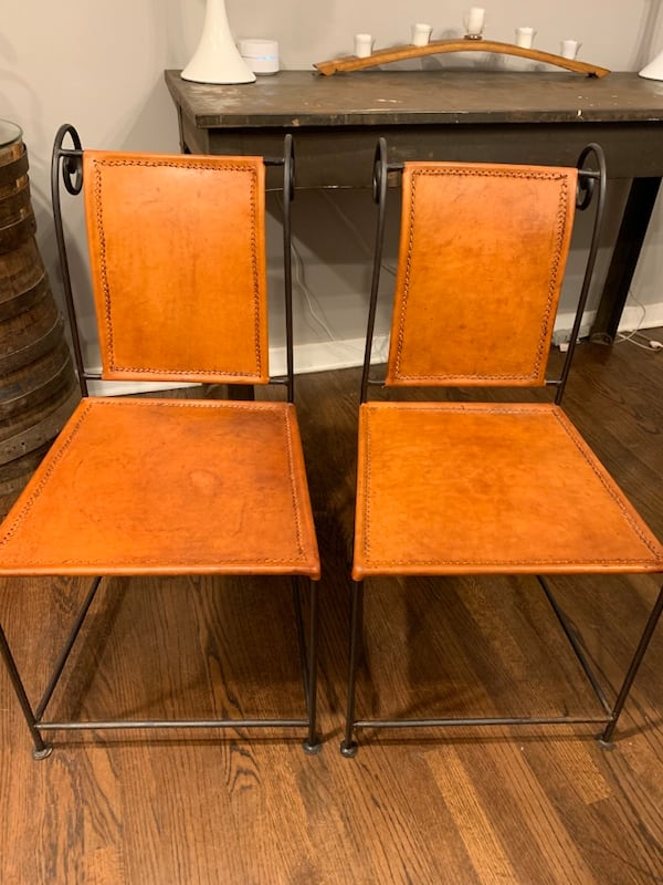 2 Metal and Leather Chairs b3843763-d3de-421d-b514-0753c5b1bd9f